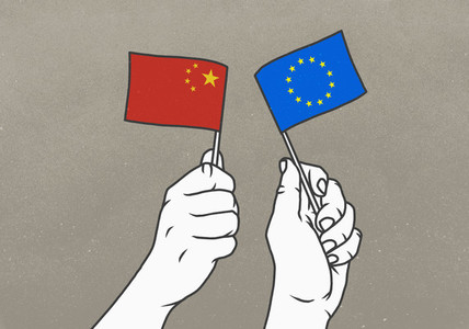 Hands waving Chinese and European Union flags