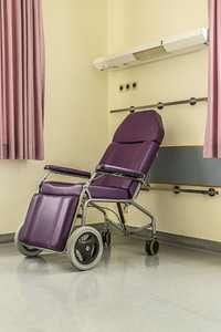 Purple reclining wheelchair in hospital room