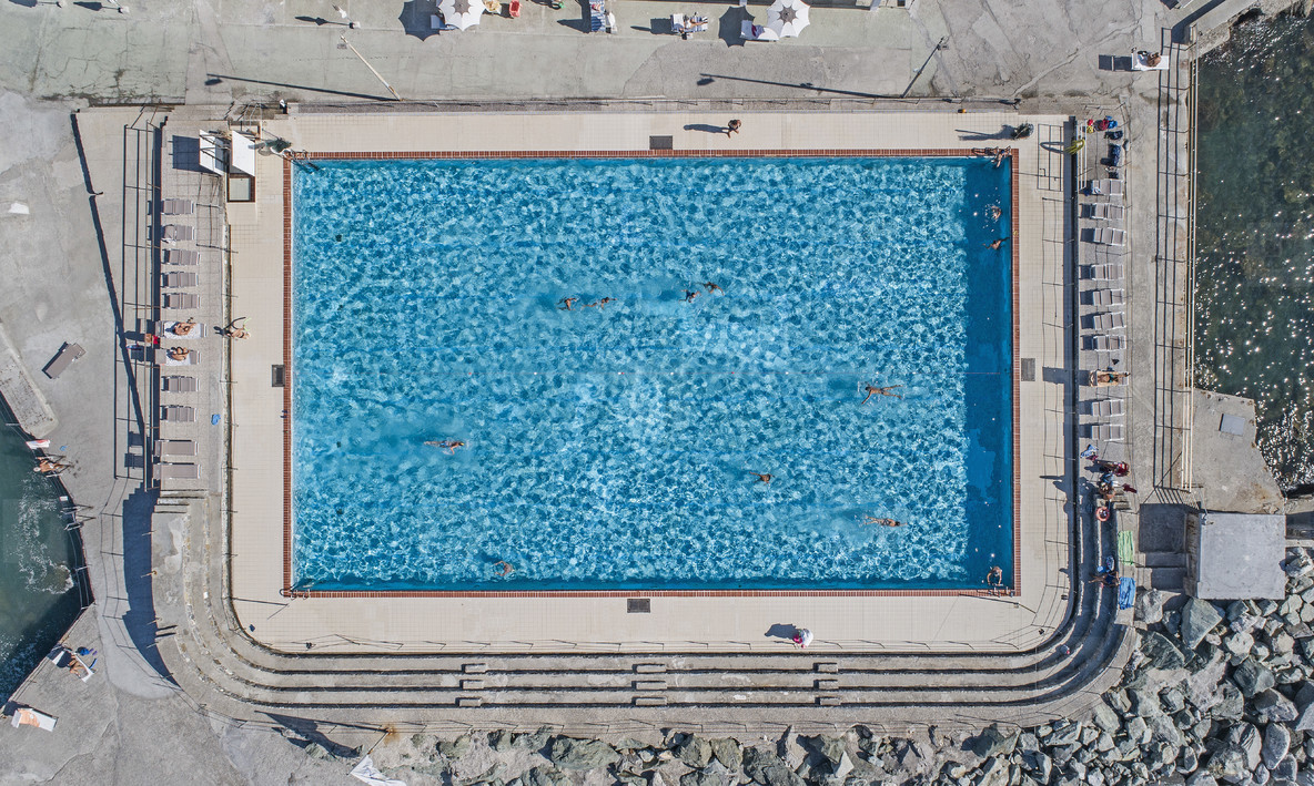 Aerial view from above tourists swimming in sunny