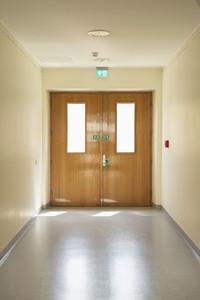 Doors at end of hospital corridor