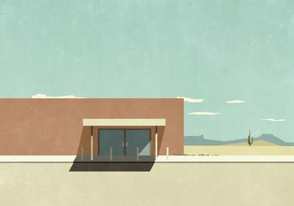 Warehouse building in sunny desert landscape