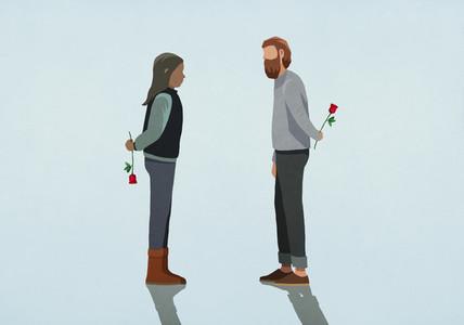 Couple holding roses behind backs