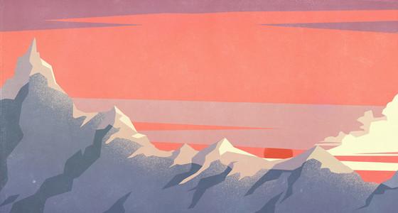 Dramatic sunset sky over mountain peaks