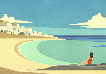 Woman relaxing on sunny idyllic summer ocean beach