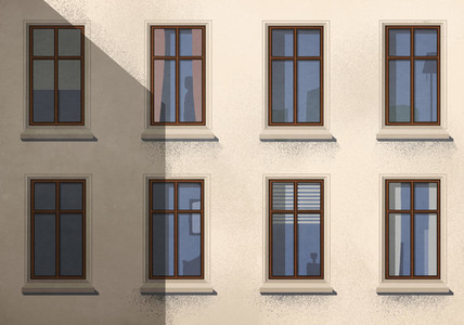 Shadow over apartment building with windows