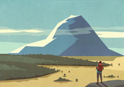 Male backpacker enjoying sunny scenic mountain landscape view