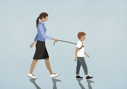 Mother walking son with harness