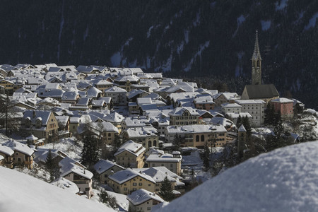 Scenic view sunny snow covered village rooftops  Switzerland