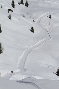 Cross country skier on snow covered mountain path  Switzerland