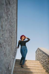 Portrait stylish woman on sunny steps
