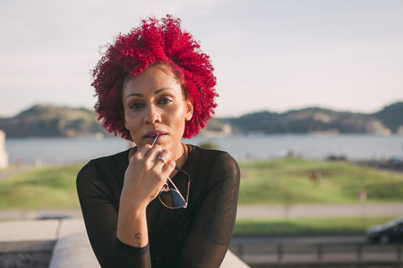 Portrait confident serious woman with red hair