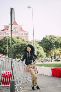 Portrait confident stylish young woman in city park