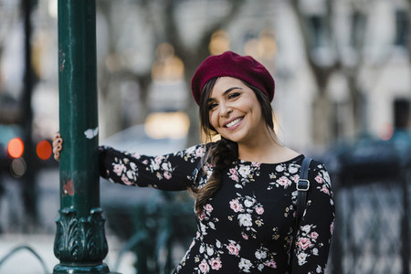 Portrait carefree young woman in beret