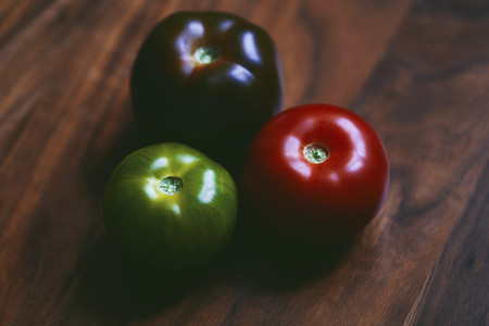 Close up red  green and purple tomatoes