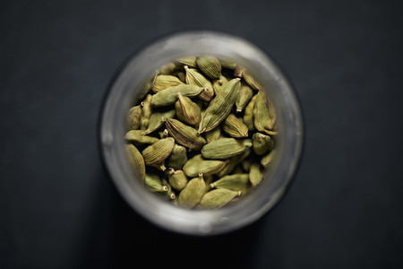 View from above cardamom seeds in spice jar