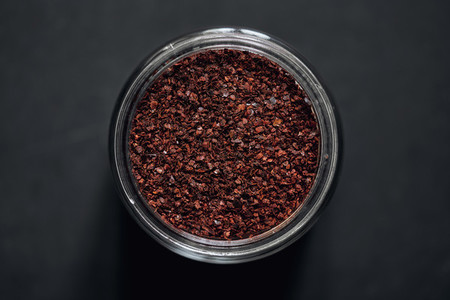 View from above Korean chili pepper flakes in spice jar