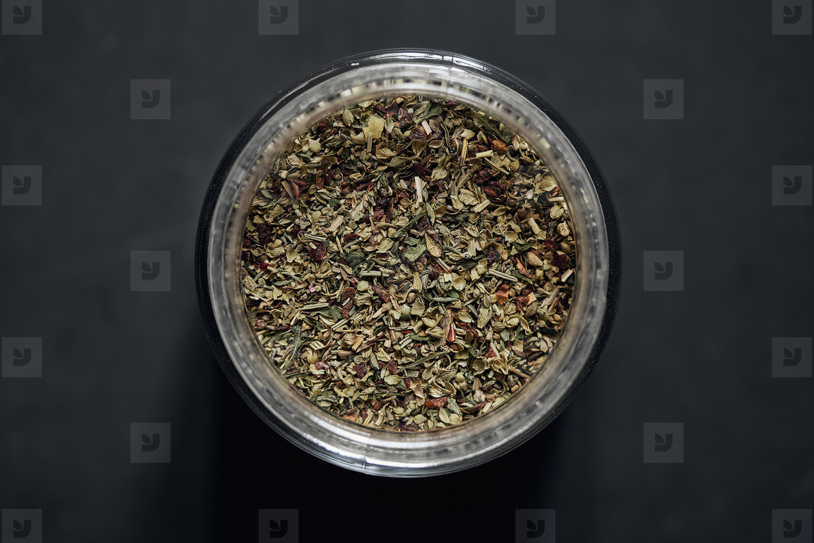View from above Italian herbs in spice jar