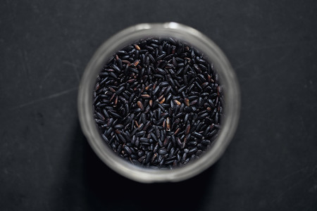 View from above black rice in spice jar