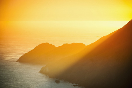 Golden sunset over ocean cliffs  San Francisco  California