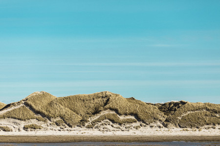 Tranquil sand dunes under sunny blue sky  Germany