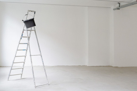 Ladder in empty room at construction site