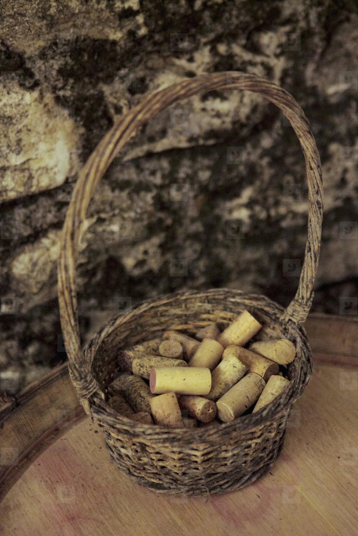 Wine corks in rustic basket on keg