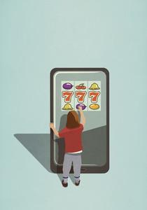 Girl playing slot machine game on large smart phone