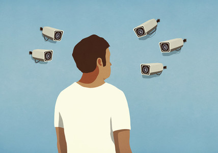 Surveillance cameras pointed at man