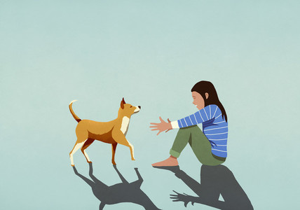 Dog walking toward woman with arms outstretched