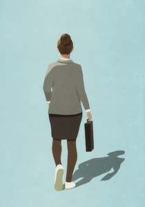 Businesswoman in sneakers walking with briefcase