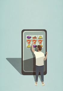 Man playing slot machine game on large smart phone