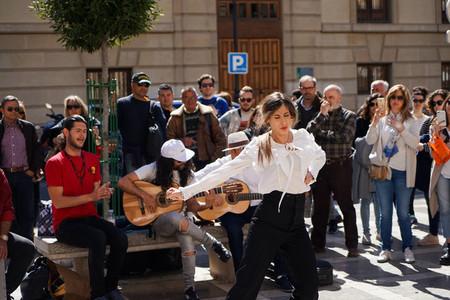 GRANADA  SPAIN 10th MARCH 2019 Flamenco dancer dances for tourists in Plaza Nueva