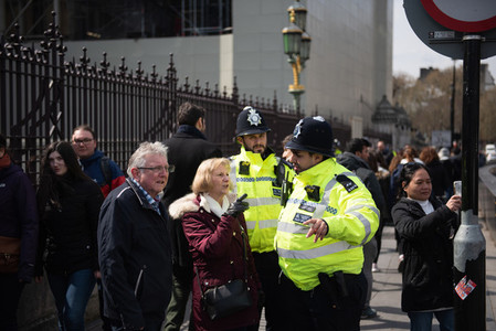 London  United Kingdom  April 13th 2019  Two police officers helping people outside Westminster Parliament