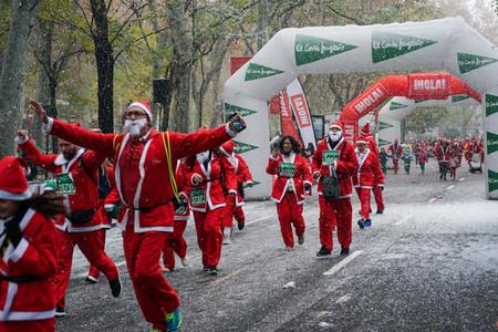 Madrid Spain December 8th 2019 Crowd of Santa Clauses running in street