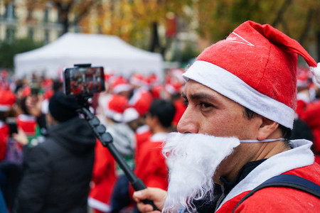 Madrid Spain December 8th 2019 Crowd of Santa Clauses running in street