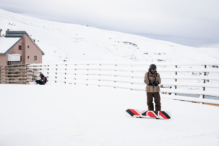 People get ready to snowboard at the Sierra Nevada ski resort