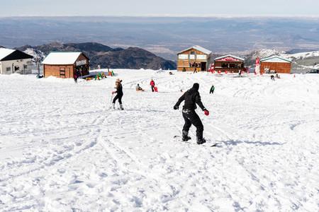 People having fun doing winter sports in Sierra Nevada