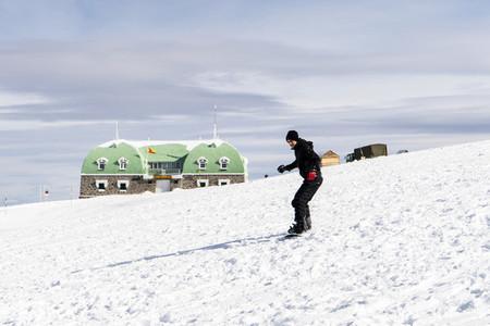 Young man snowboarding at the Sierra Nevada ski resort