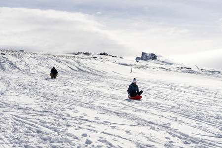 People sledding at the Sierra Nevada ski resort