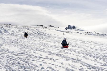 People sledding at the Sierra Nevada ski resort
