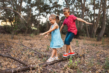 Two kids playing in the forest