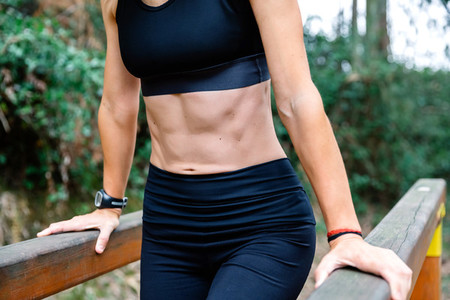 Athlete woman training on parallel bars