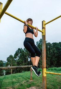Female athlete doing pull up exercises