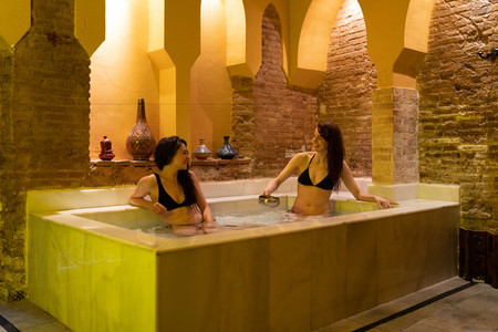 Two women enjoying Arabic baths Hammam in Granada