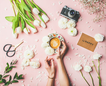 Female hands holding coffee flowers film camera and sign happy