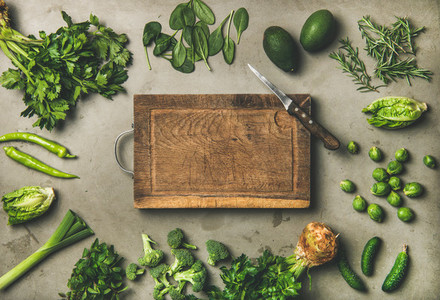 Healthy vegan ingredients and wooden board in center