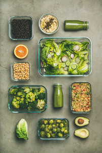 Healthy vegan dishes and juice in bottle on concrete background