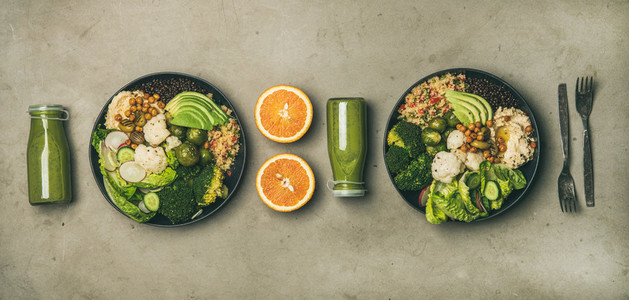 Healthy dinner with superbowls and green smoothies in bottles