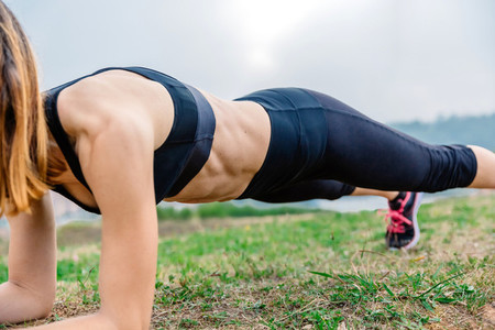 Female athlete training doing plank