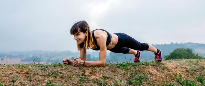 Female athlete training doing plank